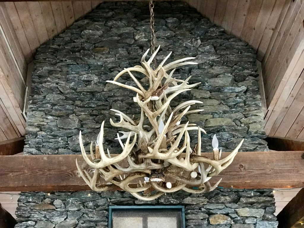 lodge chandelier in front of fireplace